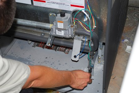 Inspect Raypak pool heater for damage