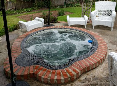hot tub filter repair for this Encinitas mosaic tiled in-ground spa