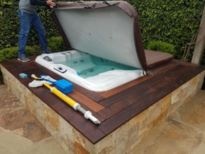Preparing to clean Sundance hot tub in Rancho Santa Fe