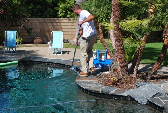 Cleaning-pool-tie-during-pool-service-in-Carmel-Valley,-92130
