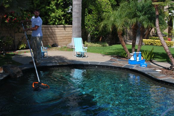 Skimming-the-surface-during-pool-service-in-Carmel-Valley