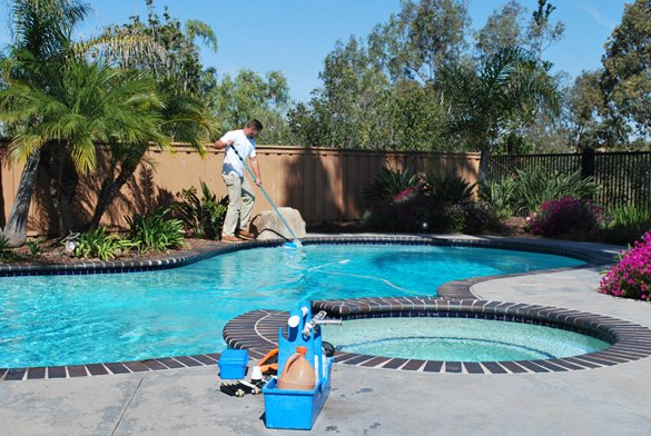 Cleaning-pool-tile-during-pool-service-in-Carmel-Valley