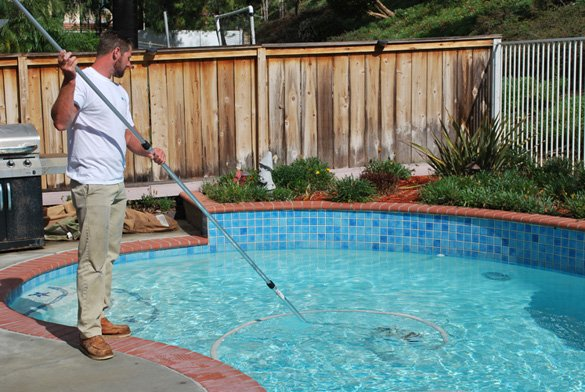 Vacuuming-pool-at-pool-service-account
