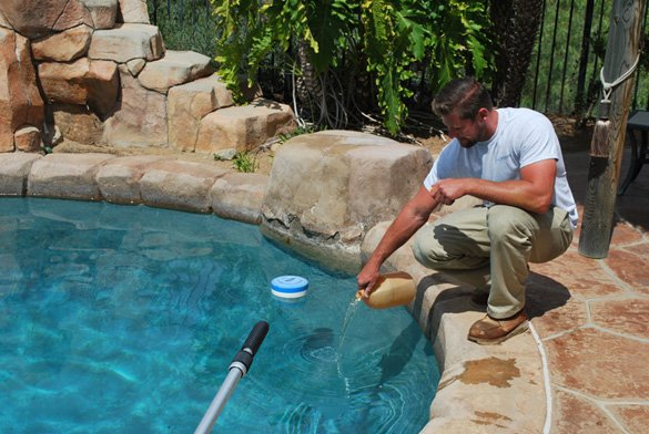 Adding-chemicals-during-our-pool-service-in-Poway,-CA