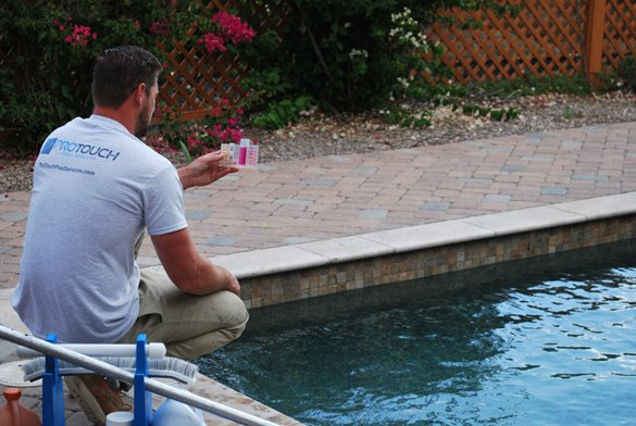 Checking-pool-chemicals-during-pool-service