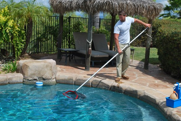 Netting-the-swimming-pool-in-Poway,-Ca