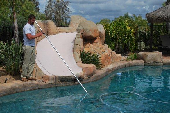 Vacuuming-the-swimming-pool-during-pool-maintenance