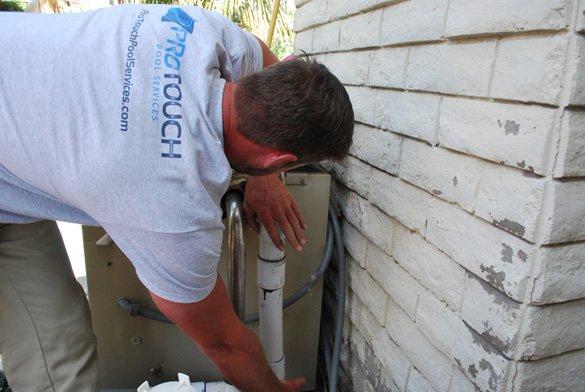 Completing the pool heater repair plumbing leak in San Diego