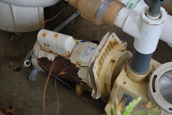Taking-apart-old-Pentair-pool-motor-in-Point-Loma,-CA