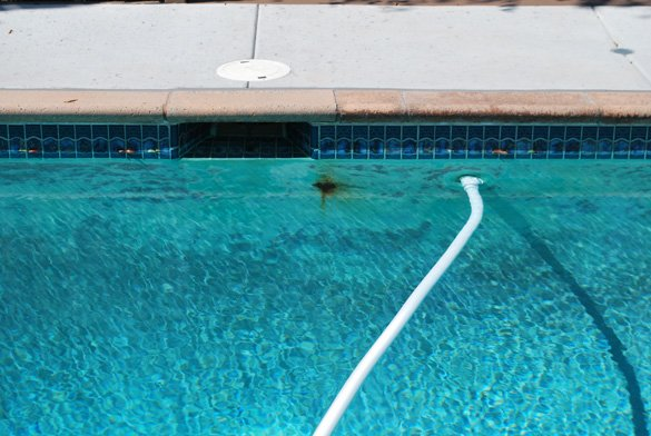 plaster rust spot on the pool wall by the skimmer