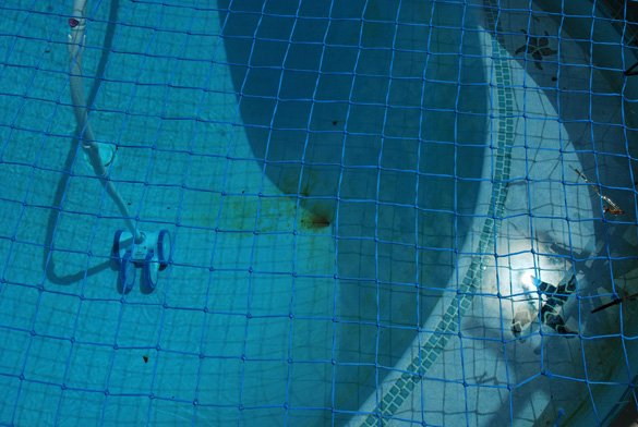 swimming pool rust spot and safety net