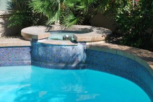concrete pool coping and glass tile fountain