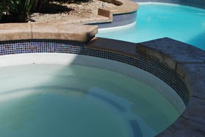 hot-tub-with-glass-tile-and-concrete-coping - Copy