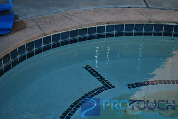flagstone pool coping with blue pool tile