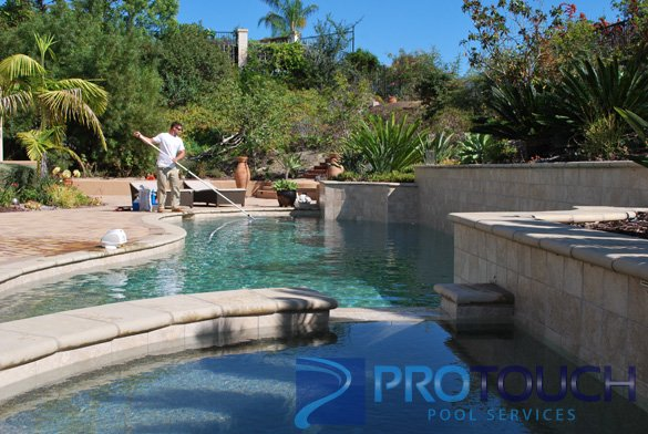 pool and spa with a pebble pool finish