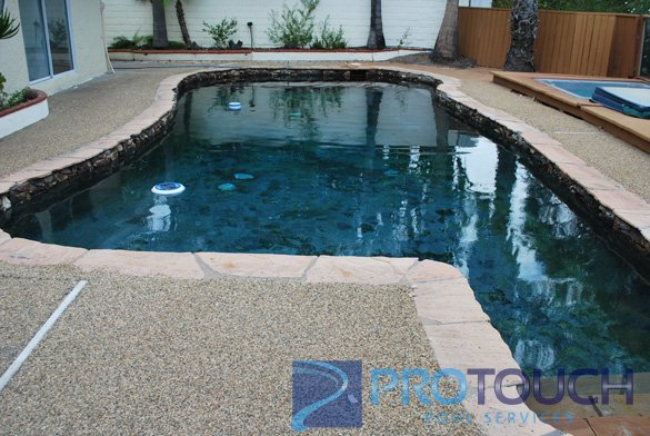 swimming pool with stand alone hot tub