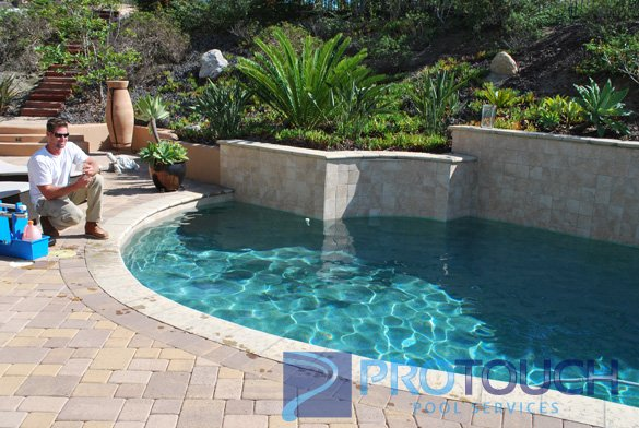 tan natural stone pool coping
