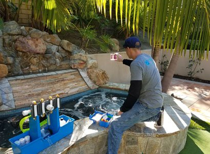 Checking and balancing hot tub water chemistry