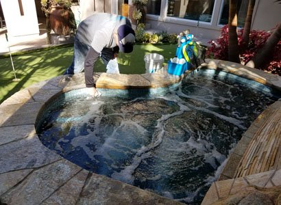 removing hot tub dirt and debris from tile