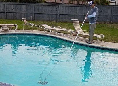 Vacuuming Poway swimming pool