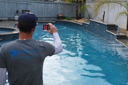 Checking pool water chemistry in Scripps Ranch