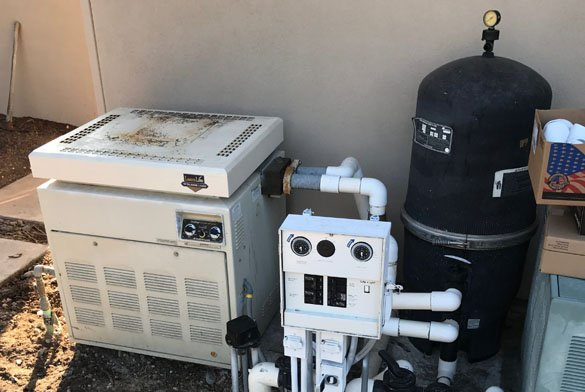 Old pool pump, pol heater and pool filter