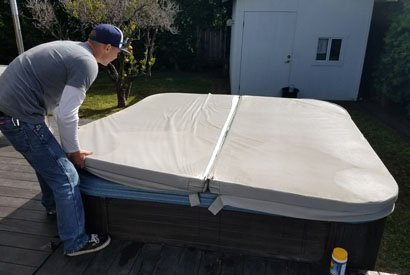 Hot tub cover removal during weekly service