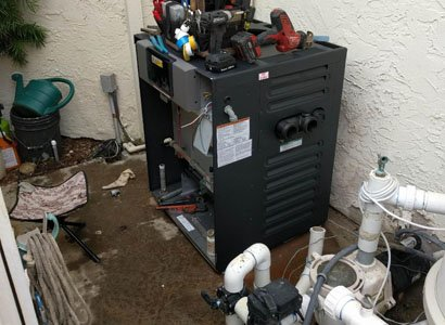 Setting new pool heater in place in Del Mar, CA