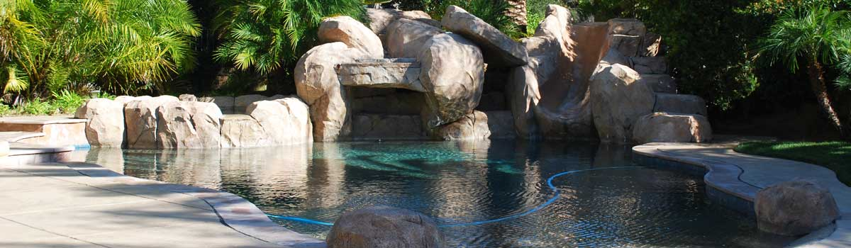 carmel Valley pool cleaning for pool with a large artificial rock water feature