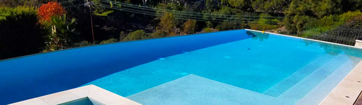 La Jolla pool service with pebble surface and large vanishing edge