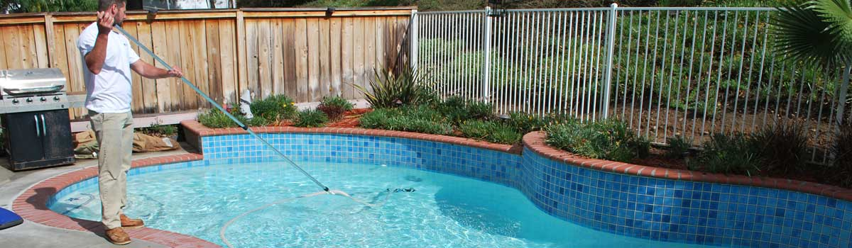 Pool service Tierrasanta, 92124 with pretty blue pool tile and white plaster finish